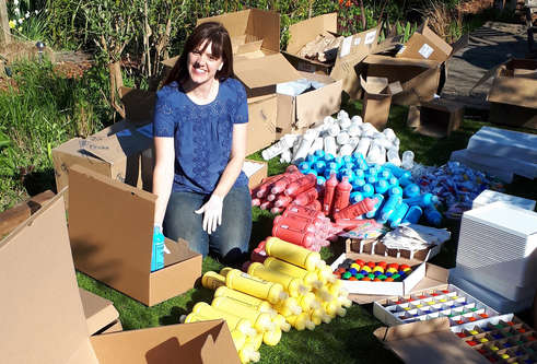 Vicky Armstrong packing boxes of art supplies