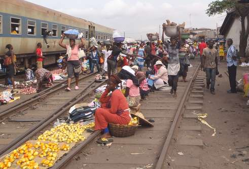 People selling goods at a railway station in Africa