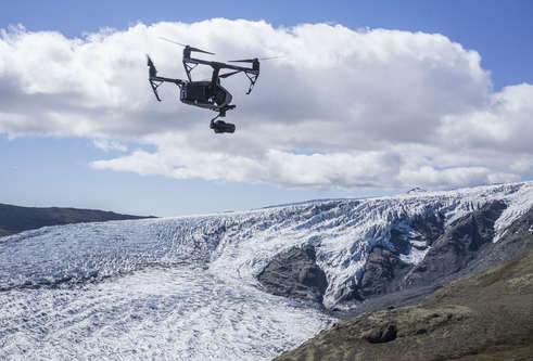 Photograph of a drone in flight above Skálafellsjökull glacier