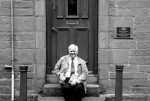 Eddie Small sat on the steps of Mary Lily Walker's house