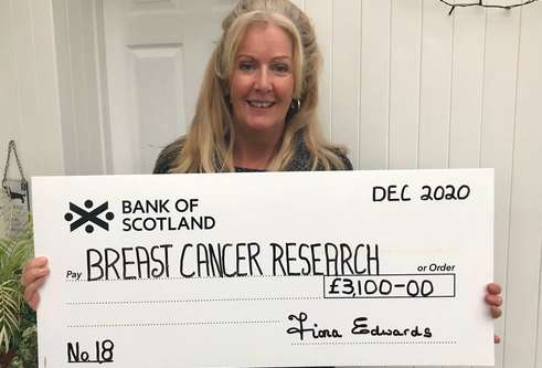 Fiona Edwards with cheque for breast cancer research