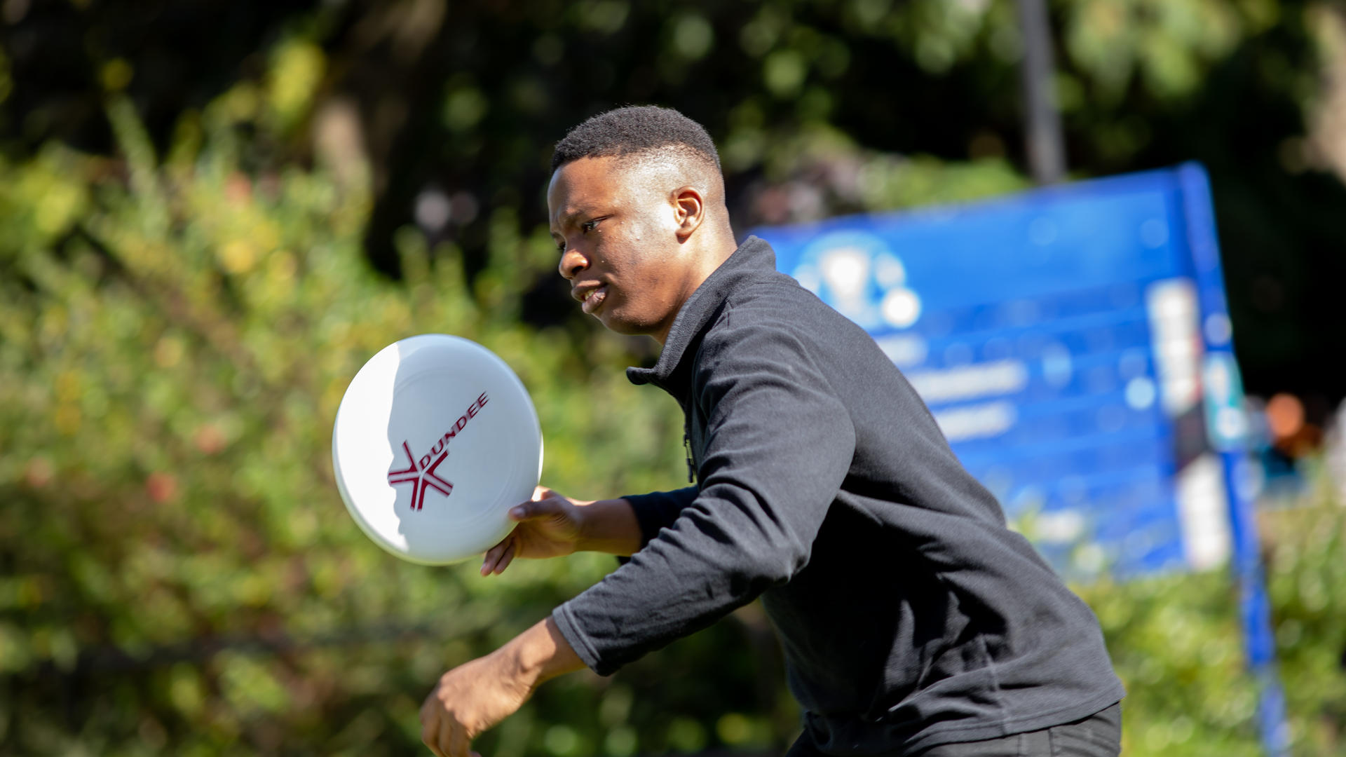 Student playing frisbee