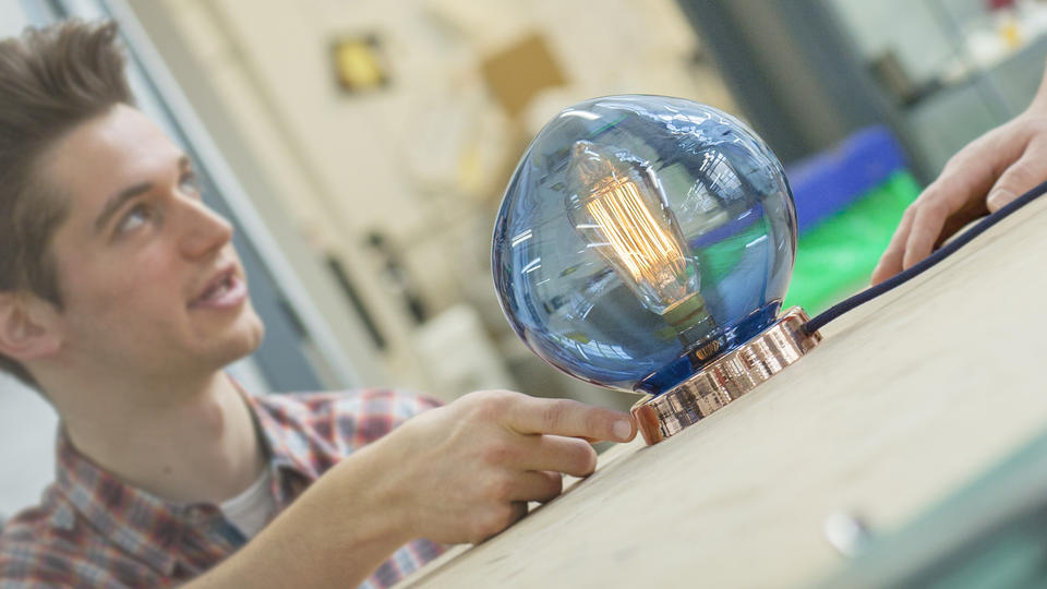 Student with large blue light bulb