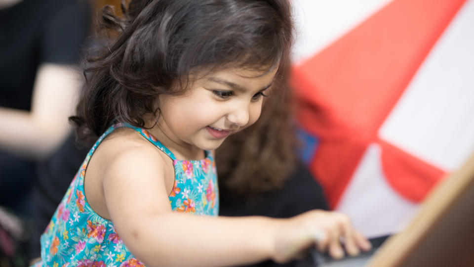 Little girl using a tablet