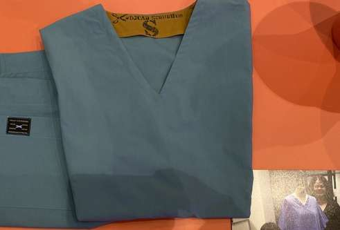 tayside teal scrubs set folded on table